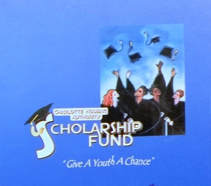 Charlotte Housing Authority Scholarship Fund with people in caps and gowns