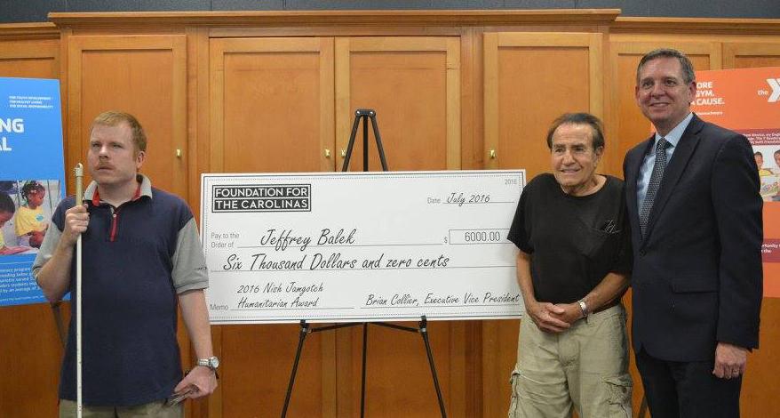 Nish Jamgotch Jr. gives his humanitarian award.